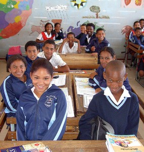 School children at Imperial Primary School in Eastridge, Mitchell's Plain, Cape Town, South Africa. Picture taken by Henry Trotter, 2006 (via Wikimedia Commons)