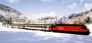 A train rolls through the snowy Siberian landscape. Photo via YWNR.
