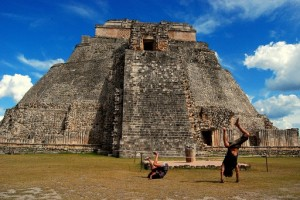 Attempting handstand poses at Uxmal's Mayan Pyramid. 