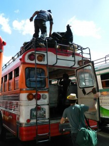 Me about to hop on the back of a Guatemalan Chicken Bus.