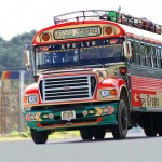 Another great Chicken Bus, outside Guatemala City. Photo via Wikimedia, by DavidDennisPhotos.com