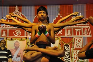 A Yoga Show in Kolkata. Photo via Wikimedia, by Biswarup Ganguly.