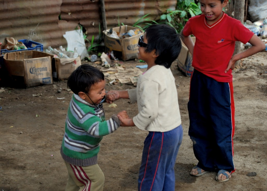 Even in a dirt lot construction site, these kids were having a blast, dancing and being silly.