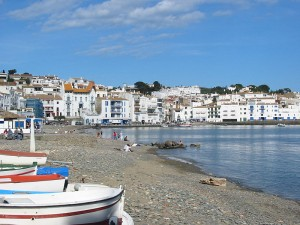 Cadaques harbor on Spain's Costa Brava. Photo via Wikimedia, by Gabriele Delhey.